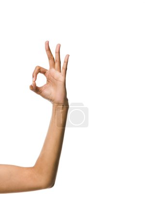 cropped view of african american woman showing ok sign isolated on white