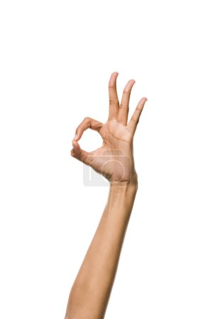 cropped view of young african american woman showing ok sign isolated on white