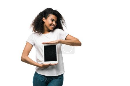Photo for Happy african american girl holding digital tablet with blank screen isolated on white - Royalty Free Image