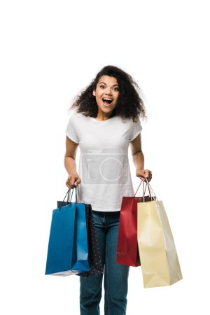 Photo for Excited african american girl holding shopping bags isolated on white - Royalty Free Image