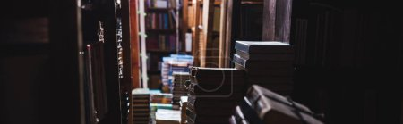 Photo for Panoramic shot of vintage books on shelves in library - Royalty Free Image