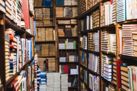 Photo for Selective focus of retro books on shelves in library - Royalty Free Image