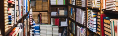 Photo for Panoramic shot of retro books on shelves in library - Royalty Free Image