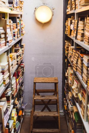 Photo for Vintage books on wooden shelves and ladder in library - Royalty Free Image