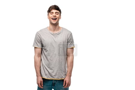 cheerful young man in grey t-shirt smiling at camera isolated on white