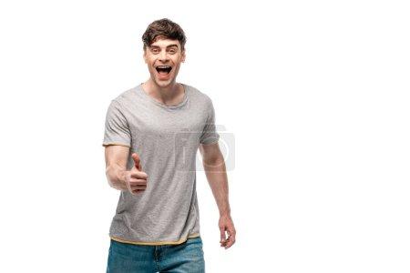 Photo pour Homme heureux montrant pouce vers le haut tout en regardant la caméra isolée sur blanc - image libre de droit