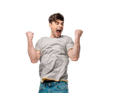Photo for Happy young man showing triumph gesture and screaming isolated on white - Royalty Free Image