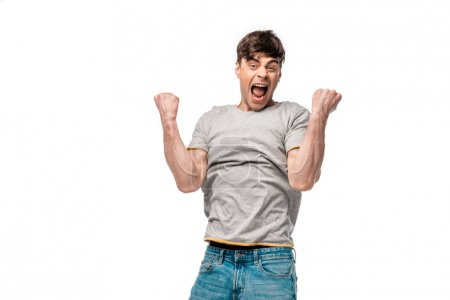 Photo for Excited young man showing winner gesture while looking at camera isolated on white - Royalty Free Image