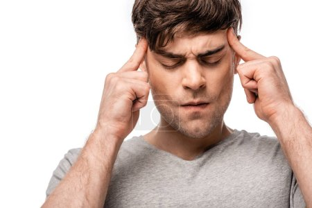 Foto de Exhausted man suffering from migraine and touching head with fingers isolated on white - Imagen libre de derechos
