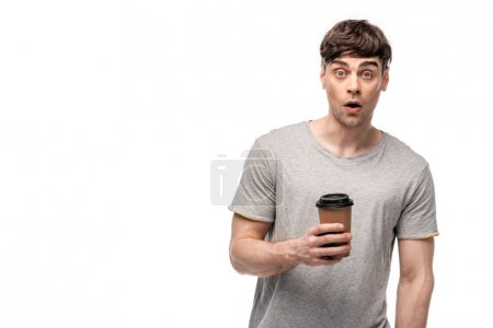 Photo for Surprised young man looking at camera while holding coffee to go isolated on white - Royalty Free Image