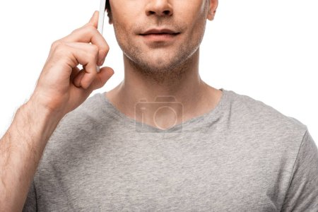 Photo for Cropped view of young man talking on smartphone isolated on white - Royalty Free Image