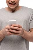 "Постер, картина, фотообои ""cropped view of man using smartphone and grimacing isolated on white"""