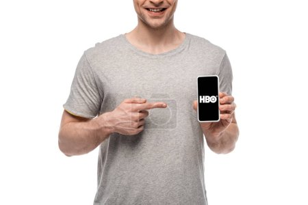 KYIV, UKRAINE - MAY 16, 2019: cropped view of smiling man pointing at smartphone with HBO app, isolated on white