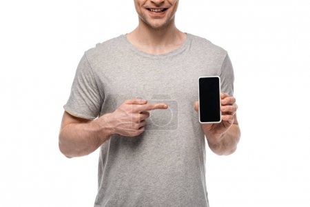 Photo for Cropped view of smiling man pointing with finger at smartphone with blank screen isolated on white - Royalty Free Image