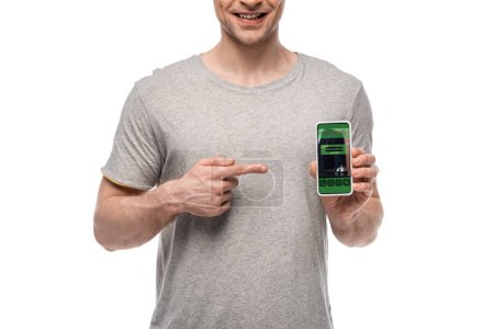 Photo for Cropped view of man pointing at smartphone with booking app, isolated on white - Royalty Free Image