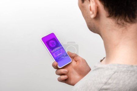 Photo for Cropped view of man using smartphone with shopping app, isolated on grey - Royalty Free Image