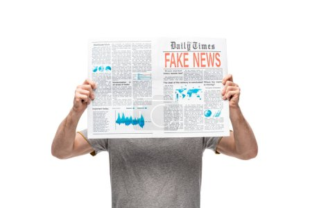 Photo for Man in grey t-shirt holding newspaper with fake news isolated on white - Royalty Free Image