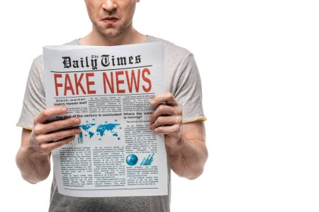 Photo for Cropped view of displeased man reading newspaper with fake news isolated on white - Royalty Free Image