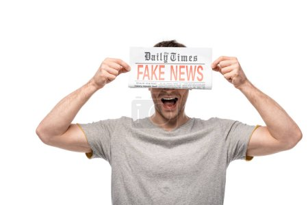 Photo for Young man showing newspaper with fake news isolated on white - Royalty Free Image