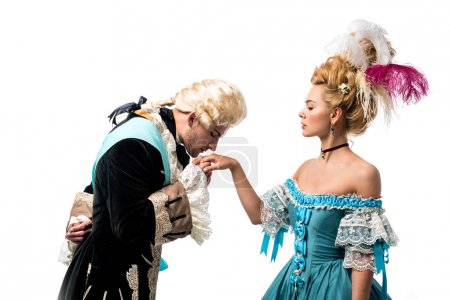 Photo for Handsome gentleman kissing hand of beautiful victorian woman in blue dress isolated on white - Royalty Free Image
