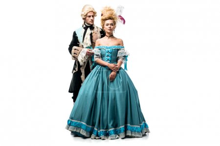 Photo for Handsome man in wig standing near attractive victorian woman in blue dress isolated on white - Royalty Free Image