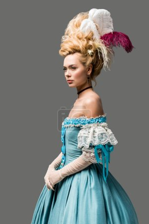 Photo for Beautiful victorian woman in wig standing isolated on grey - Royalty Free Image
