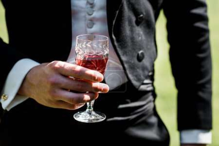 Photo for Cropped view of victorian man in suit holding wine glass with drink - Royalty Free Image