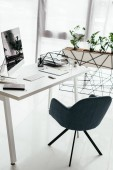 """Постер, картина, фотообои """"white table with computer, notebook, document tray, glass near office chair and flowerpot with plant"""""""