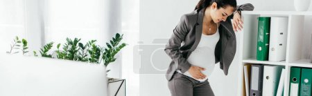 Foto de Panoramic shot of pregnant woman leaning on bookcase with folders in office - Imagen libre de derechos
