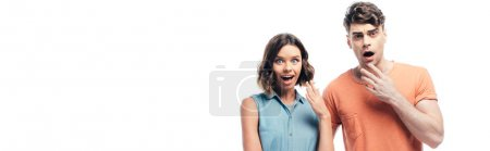 Photo for Panoramic shot of shocked man and woman looking at camera isolated on white - Royalty Free Image