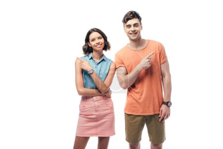Foto de Cheerful man and woman gesturing with fingers and smiling at camera isolated on white - Imagen libre de derechos