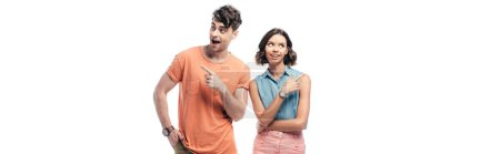 Foto de Panoramic shot of cheerful man and woman pointing with fingers and looking away isolated on white - Imagen libre de derechos
