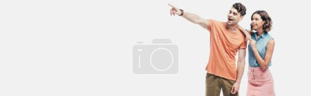Photo pour Panoramic shot of cheerful woman standing near smiling man pointing with finger isolated on grey - image libre de droit