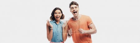 Photo for Excited man and woman looking at camera and showing yes gestures isolated on grey - Royalty Free Image
