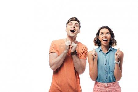 Photo pour Gai homme et femme levant les yeux et montrant s'il vous plaît gestes isolés sur blanc - image libre de droit