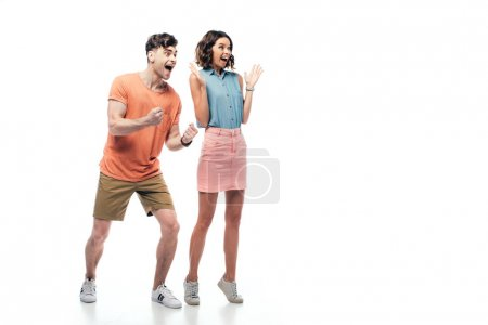 Photo for Excited man and woman showing yes gestures and looking away on white background - Royalty Free Image