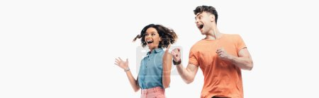 Photo for Panoramic shot of happy man and woman looking away and showing triumph gestures isolated on white - Royalty Free Image