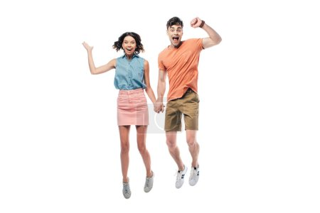 Photo for Cheerful man and woman holding hands and jumping while looking at camera isolated on white - Royalty Free Image