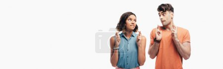 Photo for Panoramic shot of young and woman holding crossed fingers and looking at each other  isolated on white - Royalty Free Image