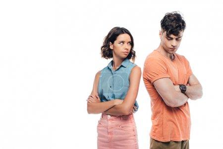 Photo pour Offensé jeune couple debout avec les bras croisés isolés sur le blanc - image libre de droit