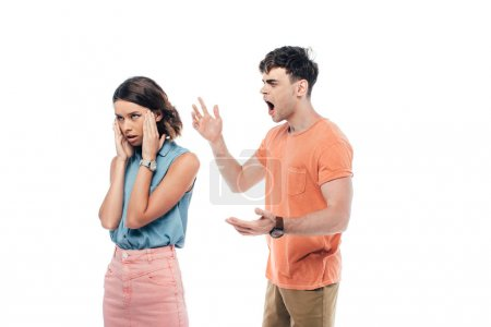 Photo for Irritated young man gesturing while quarreling at offended girlfriend isolated on white - Royalty Free Image