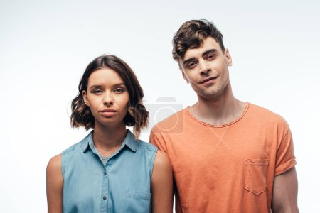 Photo for Smiling man and serious woman looking at camera on white background - Royalty Free Image