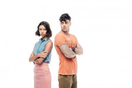 Photo pour Homme et femme offensés restant dos à dos avec les bras croisés isolés sur le blanc - image libre de droit