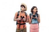 """Постер, картина, фотообои """"two cheerful young tourists with binoculars and digital camera looking away isolated on white"""""""