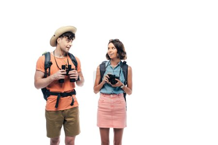 Photo for Two young tourists while digital camera and binoculars looking at each other isolated on white - Royalty Free Image