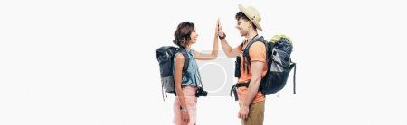 Photo for Panoramic shot of two young tourists with backpacks giving high five isolated on grey - Royalty Free Image