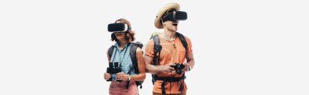 Photo for Panoramic shot of two young tourists with binoculars and digital camera using virtual reality headsets isolated on grey - Royalty Free Image