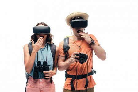 Photo for Two young shocked tourists using virtual reality headsets isolated on white - Royalty Free Image