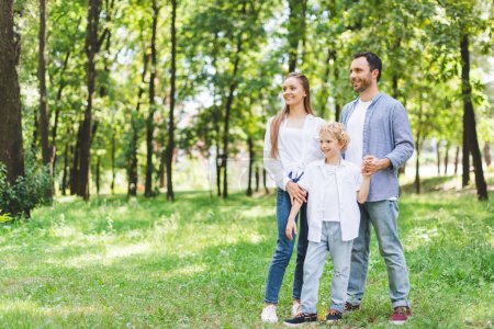 happy family holding hands in park with copy space