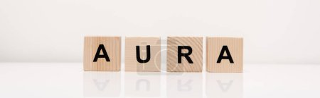 Photo for Panoramic shot of word aura lettering on wooden blocks on white - Royalty Free Image